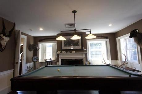 "The quartersawn oak and mahogany floors are on the first two levels, and there is a large ""man room"" with pool table and wet bar."